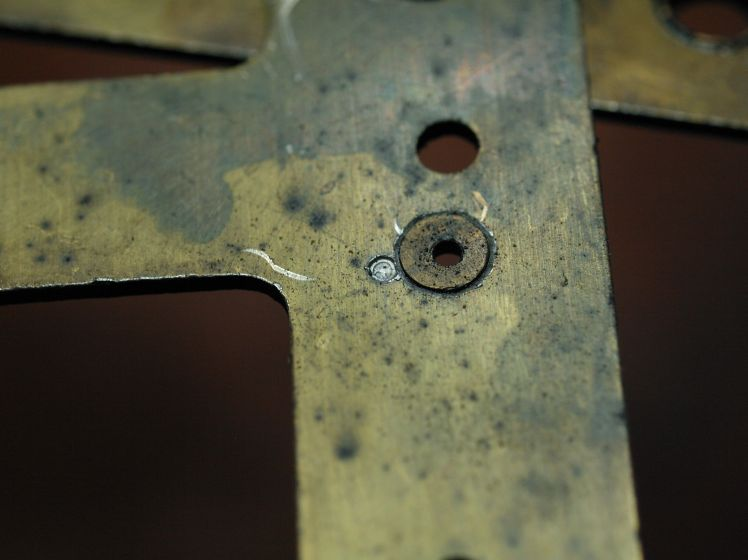 punch mark next to a bushing