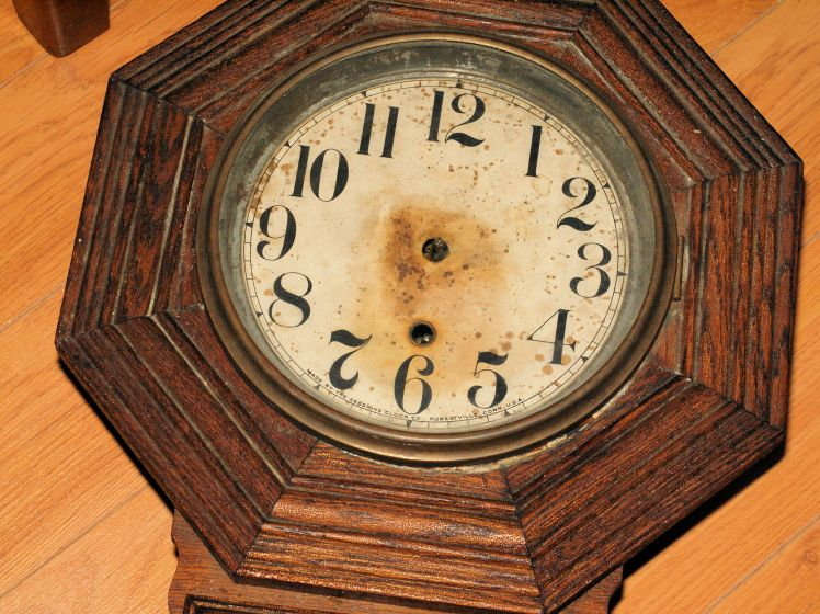 clock face showing rust staining