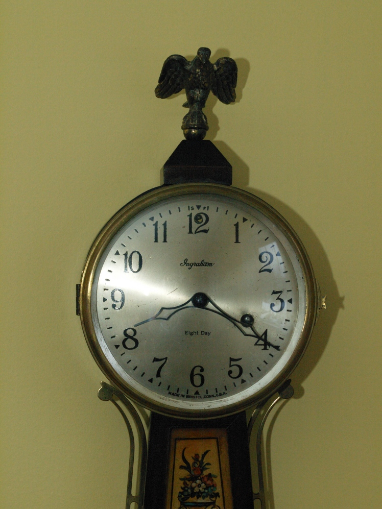 Clock face showing silvered dial and press-fit hands