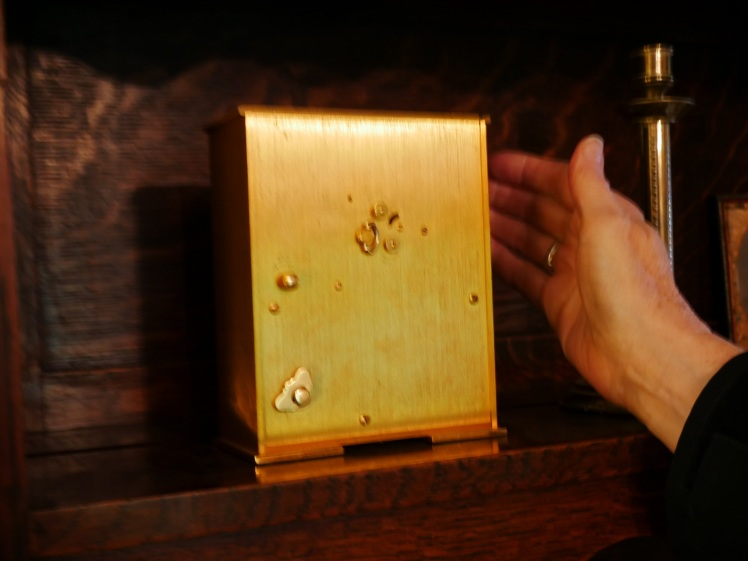 Rear of clock showing winding key for the music box on the lower left