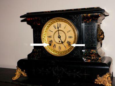 Winding arbors on a Seth Thomas mantel clock (arrows)