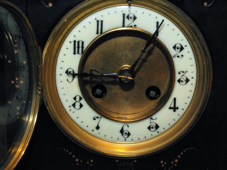 Clock face showing the two winding arbours