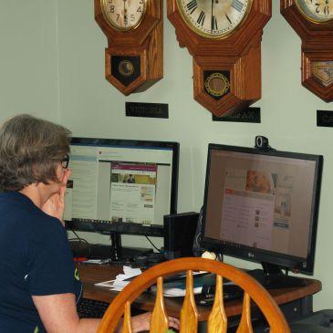 Trio of clocks above computer