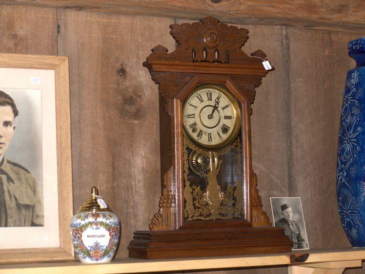 Clock displayed in antique shop