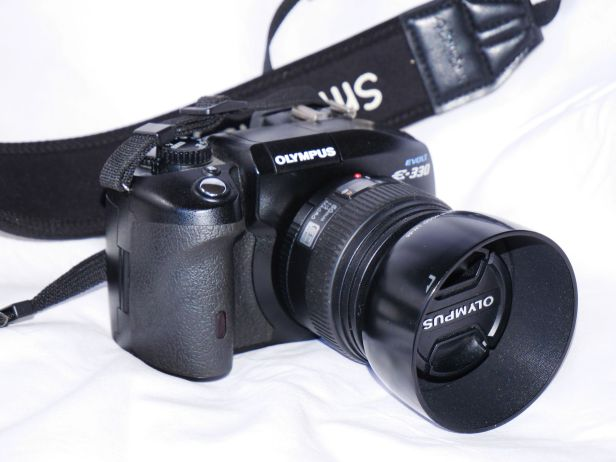 "8 megapixel E330 with 50mm F2 lens, introduced in 2006; first DSLR with ""Liveview"""