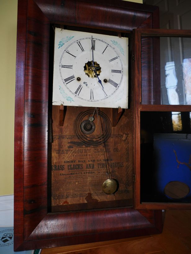Ogee clock showing replacement pendulum bob