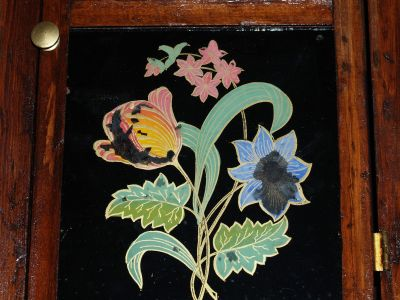 Lower tablet shiowing reverse paintiung of flowers