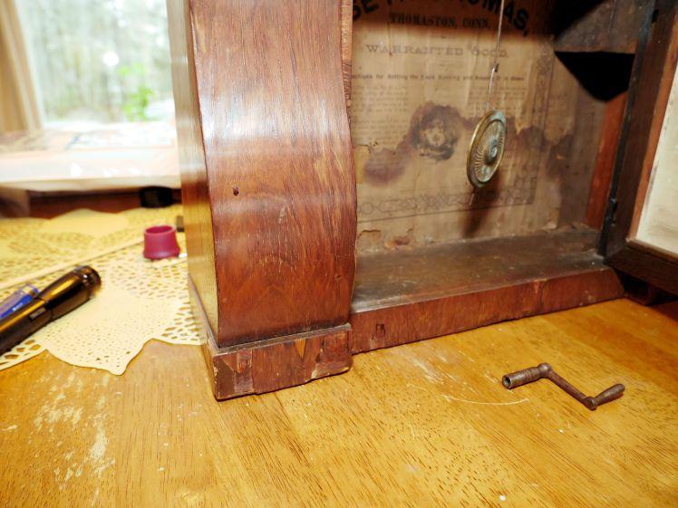 Chipped veneer below sleigh foot