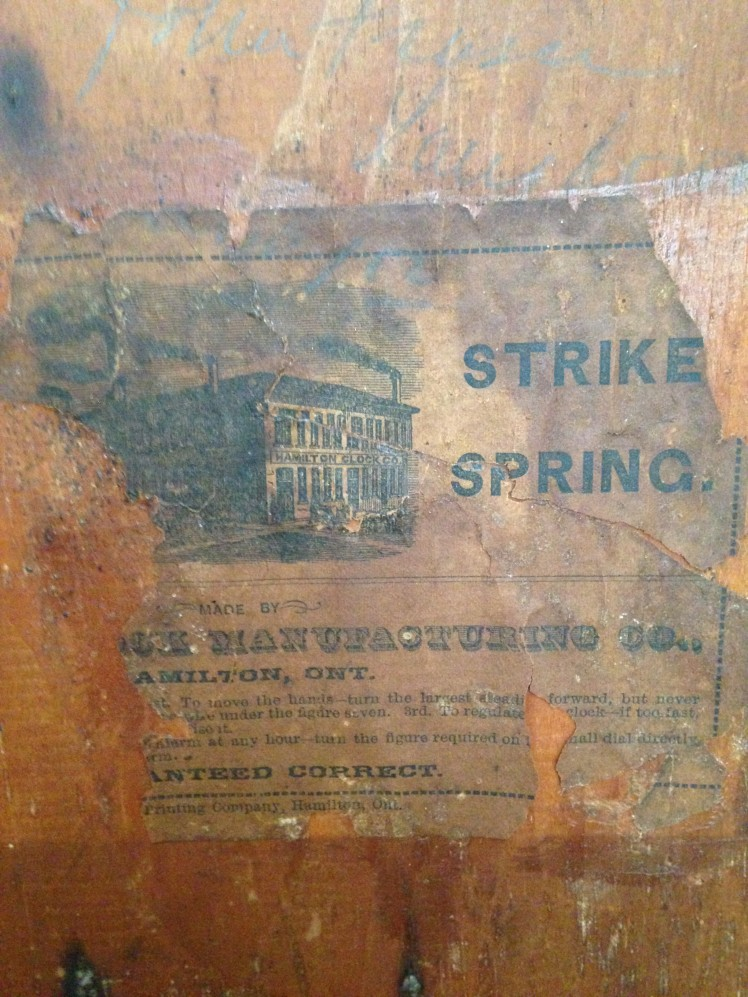 Seller's photo of the label affixed on the back of the clock