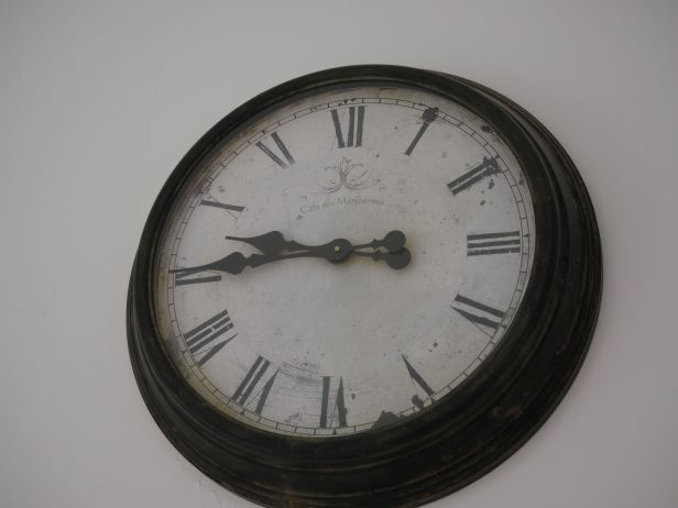 Unknown gallery clock. I could not find an opening on this clock. No arbor holes on the clock face.