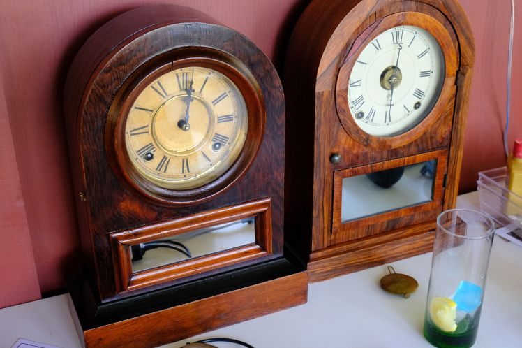 Jerome and Seth Thomas round top clocks side by side