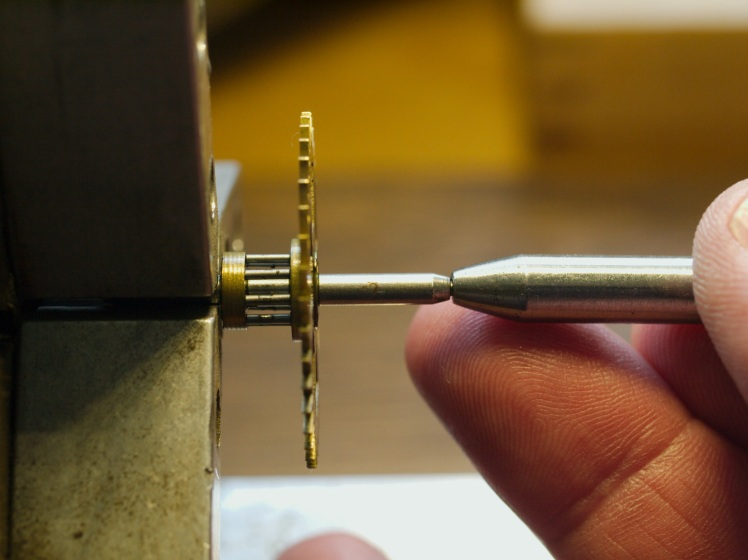 Using a hollow end punch to straighten a pivot
